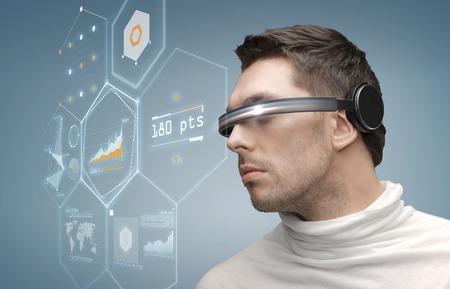 Foto de future, technology, business and people concept - man in futuristic glasses - Imagen libre de derechos