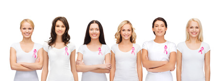 Photo pour healthcare and medicine concept - group of smiling women in blank t-shirts with pink breast cancer awareness ribbons - image libre de droit
