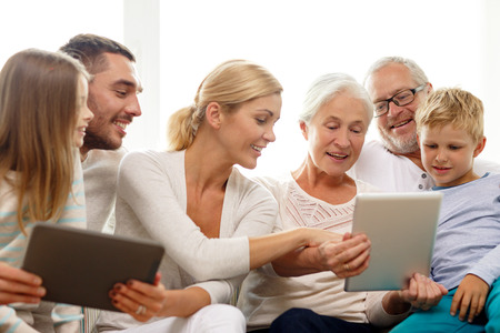 Photo for family, generation, technology and people concept - smiling family with tablet pc computers at home - Royalty Free Image