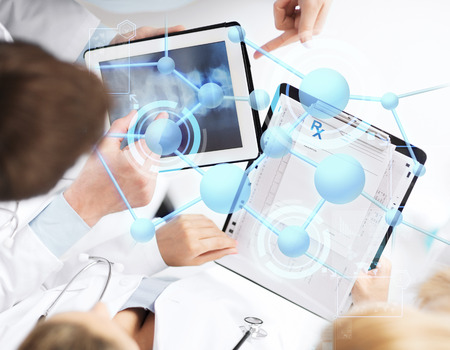 Photo pour healthcare, technology, medicine and people concept - group of doctors with tablet pc, clipboard and molecular projection - image libre de droit