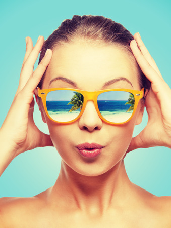 Photo for travel, vacation, summer holidays and happy people concept - portrait of amazed teenage girl in sunglasses with beach reflection - Royalty Free Image