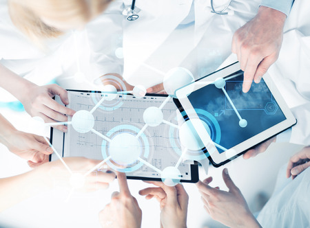 Photo for healthcare, technology, medicine and people concept - group of doctors with tablet pc, clipboard and molecular projection - Royalty Free Image