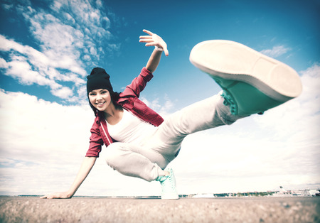 Photo for sport, dancing and urban culture concept - beautiful dancing girl in movement - Royalty Free Image