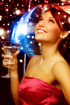 luxury, vip, nightlife, party, christmas, x-mas, new year\'s eve concept - beautiful woman in evening dress with cocktail and disco ball