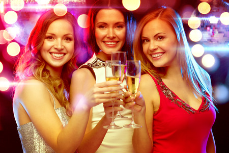 Photo pour new year, celebration, friends, bachelorette party, birthday concept - three beautiful woman in evening dresses with champagne glasses - image libre de droit