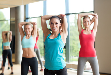 Photo pour fitness, sport, training, gym and lifestyle concept - group of women working out in gym - image libre de droit