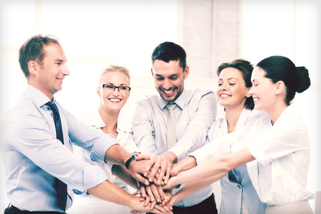 Photo pour picture of happy business team celebrating victory in office - image libre de droit
