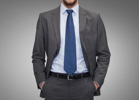 Foto de business, people and office concept - close up of businessman over gray background - Imagen libre de derechos
