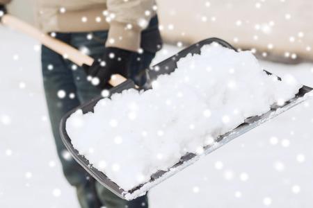 Foto de transportation, winter, people and vehicle concept - closeup of man digging snow with shovel - Imagen libre de derechos
