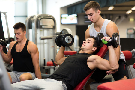 Photo pour sport, fitness, lifestyle and people concept - group of men with dumbbells in gym - image libre de droit