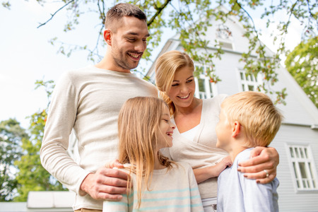 Photo for family, happiness, generation, home and people concept - happy family standing in front of house outdoors - Royalty Free Image