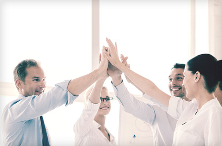 Photo pour success and winning concept - happy business team giving high five in office - image libre de droit