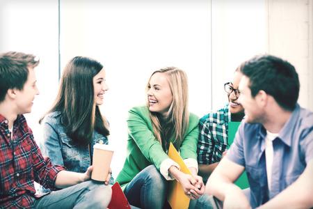 Foto de education concept - students communicating and laughing at school - Imagen libre de derechos