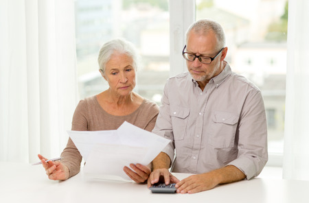 Photo for family, business, savings, age and people concept - senior couple with papers and calculator at home - Royalty Free Image