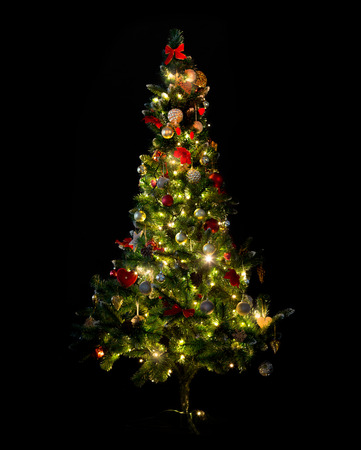 Photo pour winter, holidays, decoration and illumination concept - beautiful decorated and illuminated christmas tree over black background - image libre de droit