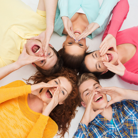 Photo for friendship, youth, gesture and people - group of smiling teenagers lying on floor in circle and shouting - Royalty Free Image