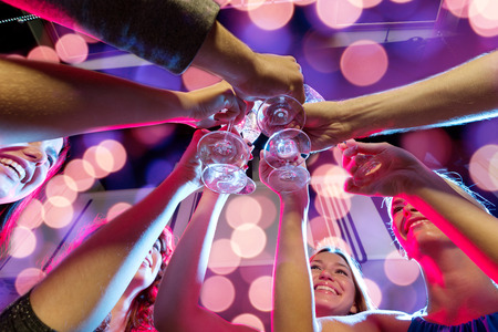 Photo for party, holidays, celebration, nightlife and people concept - smiling friends with glasses of champagne in club - Royalty Free Image