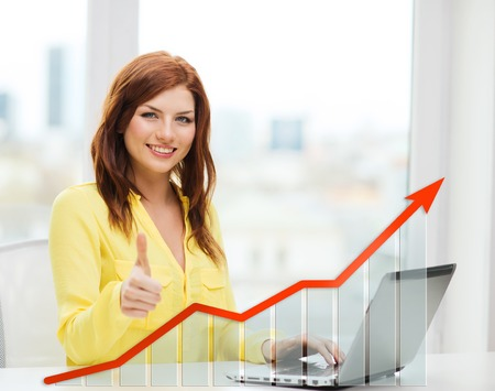 Photo for people, technology, statistic sand business concept - smiling woman with laptop computer and growth chart showing thumbs up at home - Royalty Free Image