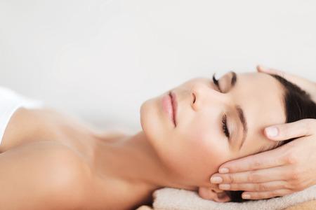 Photo pour spa, resort, beauty and health concept - beautiful woman in spa salon getting face treatment - image libre de droit