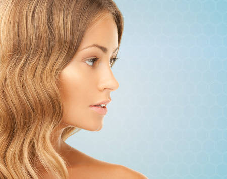 Photo for beauty, people and health concept - beautiful young woman face over blue background - Royalty Free Image