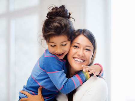 Photo pour family, children and happy people concept - hugging mother and daughter - image libre de droit