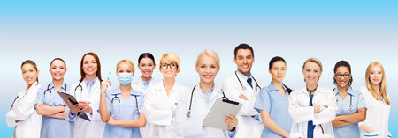 Photo for healthcare, technology and medicine concept - smiling female doctors and nurses with tablet pc computer - Royalty Free Image