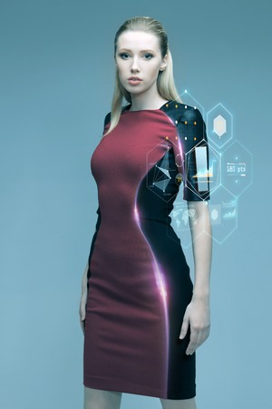 Photo pour people, future technology and science concept - beautiful futuristic woman with virtual projection over gray background - image libre de droit
