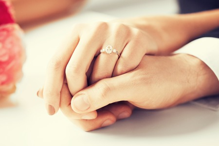 Photo pour picture of man and woman with wedding ring - image libre de droit