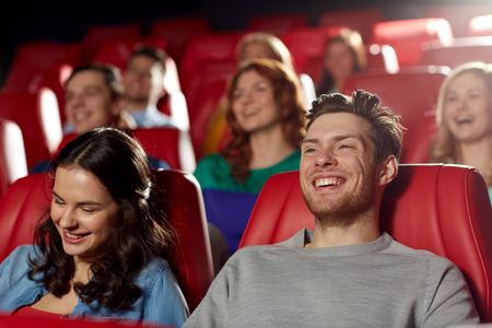 Photo for cinema, entertainment and people concept - happy friends watching comedy movie in theater - Royalty Free Image