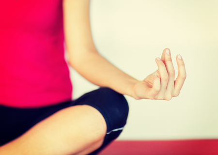 Photo pour sport and yoga concept - girl sitting in lotus position and meditating - image libre de droit