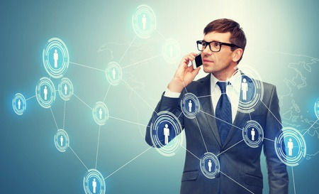 Foto de business, communication, modern technology and office concept - buisnessman with cell phone - Imagen libre de derechos