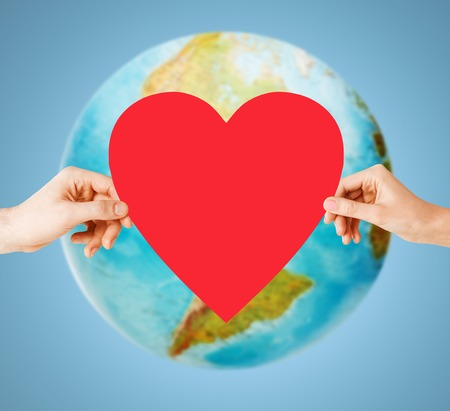 Photo pour people, love, health, environment and charity concept - close up of woman hands holding red heart over earth globe and blue background - image libre de droit