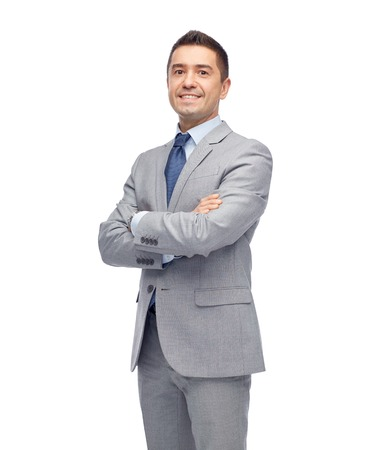 Foto de business, people and office concept - happy smiling businessman in suit - Imagen libre de derechos