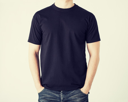 Foto de close up of man in blank t-shirt - Imagen libre de derechos