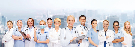 Photo for smiling female doctors and nurses with stethoscope - Royalty Free Image