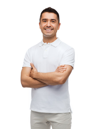 Photo for happiness and people concept - smiling man in white t-shirt with crossed arms - Royalty Free Image