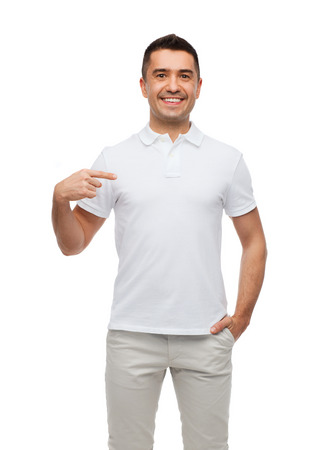 Photo pour happiness, advertisement, fashion, gesture and people concept - smiling man in t-shirt pointing finger on himself - image libre de droit