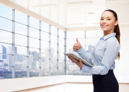 Foto de education, business and technology concept - smiling businesswoman or student with tablet pc computer over office room or new apartment background - Imagen libre de derechos