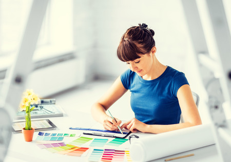 Photo pour interior design and renovation concept - woman working with color samples for selection - image libre de droit