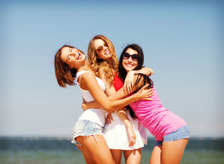 Photo for summer holidays and vacation - group of girls having fun on the beach - Royalty Free Image