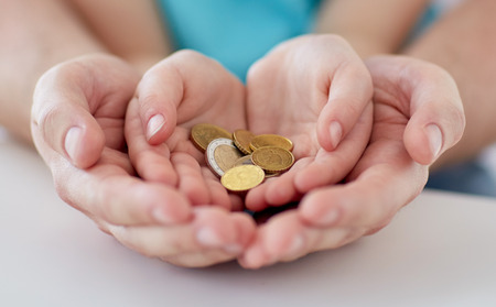 Foto de family, children, money, investments and people concept - close up of father and daughter hands holding euro money coins - Imagen libre de derechos