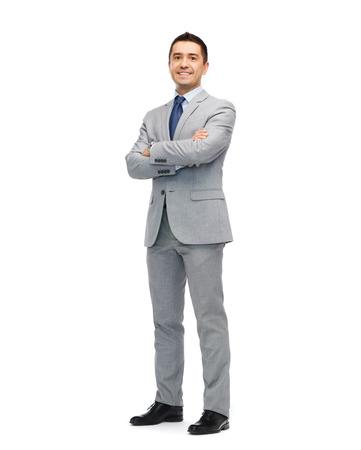 Photo pour business, people and office concept - happy smiling businessman in suit - image libre de droit