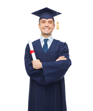 Photo for education, graduation and people concept - smiling adult student in mortarboard with diploma - Royalty Free Image