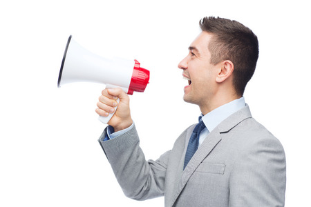 Photo for business, people and public announcement concept - happy businessman in suit speaking to megaphone - Royalty Free Image