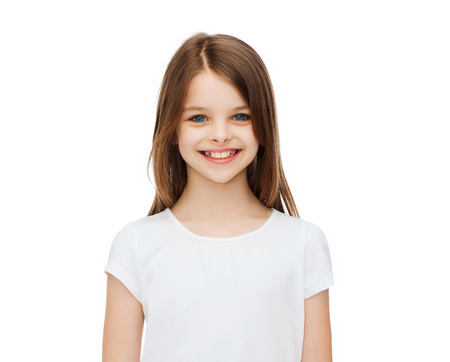 Photo for advertising and t-shirt design concept - smiling little girl in white blank t-shirt over white background - Royalty Free Image