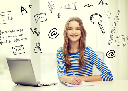 Photo pour education, technology and home concept - smiling teenage girl with laptop computer, notebook and pen at home - image libre de droit