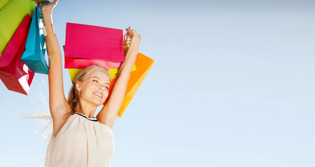Foto de shopping and tourism concept - woman with shopping bags - Imagen libre de derechos