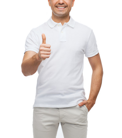Photo for happiness, gesture and people concept - smiling man showing thumbs up - Royalty Free Image