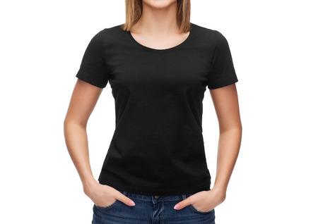 Foto de t-shirt design concept - smiling woman in blank black t-shirt - Imagen libre de derechos