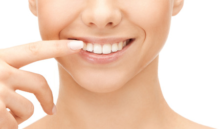 Foto für dental health concept - beautiful woman pointing to her teeth - Lizenzfreies Bild